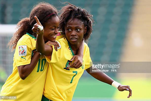Jeannette Yango of Cameroon jumps on the back of Gabrielle Onguene to congratulate her for her goal against Switzerland during the Women's World Cup...