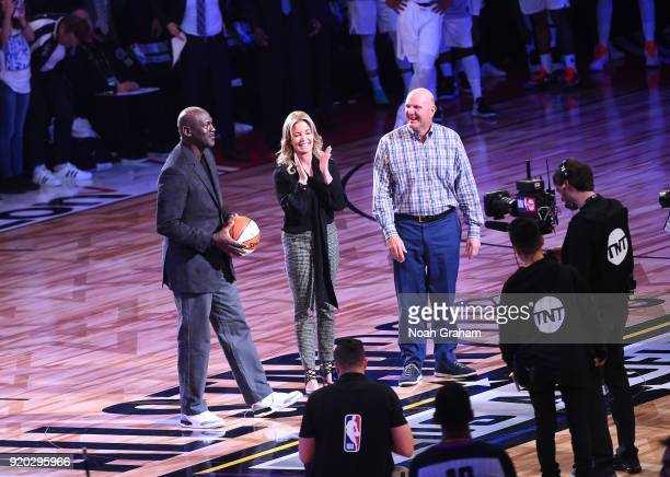 Jeannie Buss and Steve Ballmer pass on the all star ball to NBA legend Michael Jordan during the NBA AllStar Game as a part of 2018 NBA AllStar...