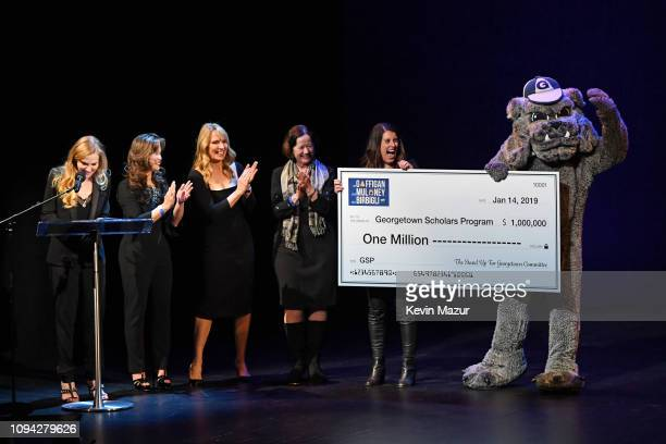 Jeannie Gaffigan Emily Chen Carrera Michelle Mauboussin Chris Deacon Missy Foy and Georgetown University's Jack the Bulldog speak onstage during...