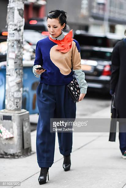 Jeannie Lee is seen outside the DKNY show wearing a striped shirt 3d graphic sweater and blue pants during New York Fashion Week Women's Fall/Winter...