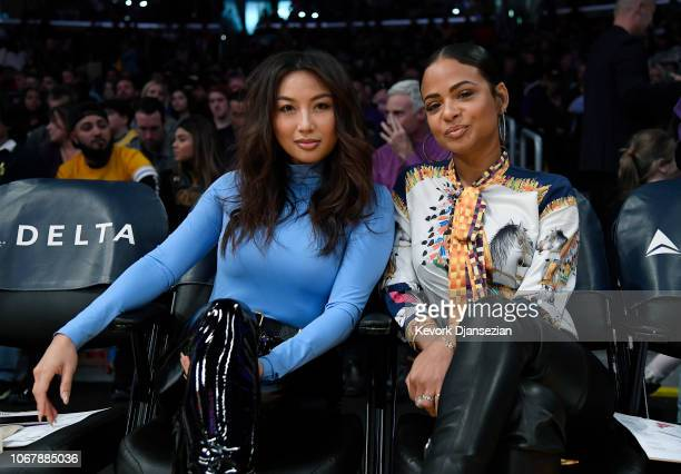 Jeannie Mai host of daytime television talk show The Real and Christina Milian pose as they attend a Los Angeles Lakers and Phoenix Suns basketball...