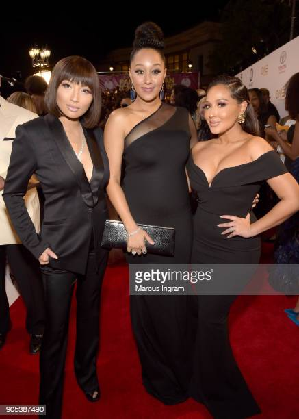 Jeannie Mai Tamera Mowry and Adrienne Houghton attend the 49th NAACP Image Awards at Pasadena Civic Auditorium on January 15 2018 in Pasadena...