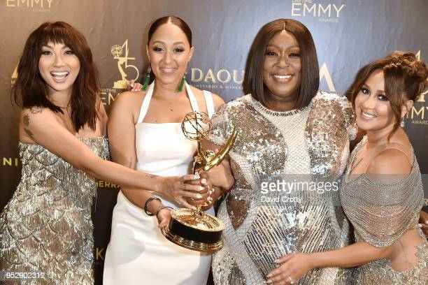 Jeannie Man Tamera MowryHousley Loni Love and Adrienne Bailon attend the 2018 Daytime Emmy Awards Press Room at Pasadena Civic Auditorium on April 29...
