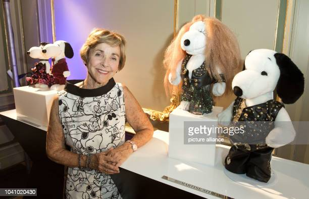 Jeannie Schulz, widow of Snoopy creator Charles M. Schulz , poses during the opening of the the exhibition 'Snoopy and Belle in Fashion' as part of...