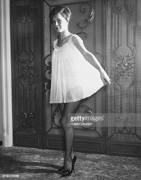 Jeannine Vautrin models a pleated white nylon nightie trimmed with lace at a show of underwear by Lejaby de Paris at London's Westbury Hotel...
