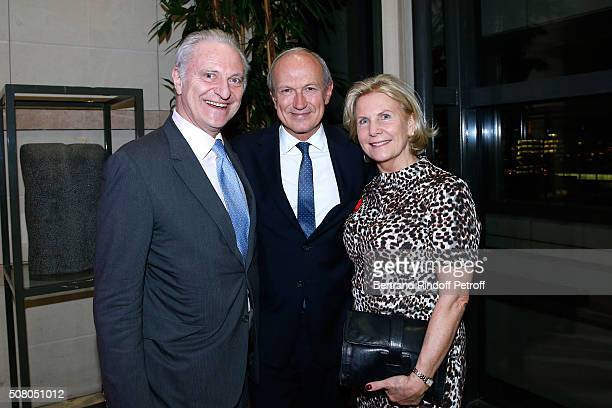 JeanPaul Agon standing between Alain Flammarion and his wife Suzanna attend President of l'Oreal JeanPaul Agon receives Insignia of Officer of the...