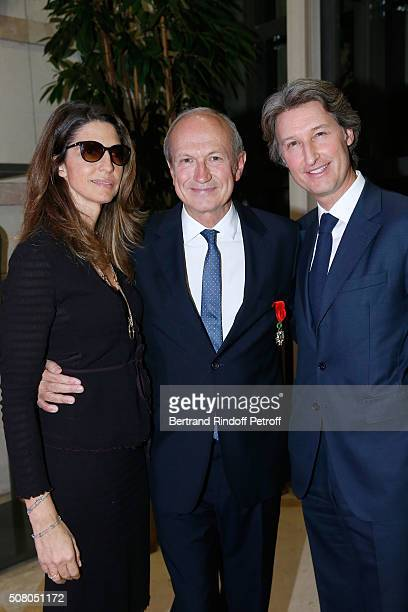 JeanPaul Agon standing between CEO 'JC Decaux' JeanCharles Decaux and his wife attend President of l'Oreal JeanPaul Agon receives Insignia of Officer...