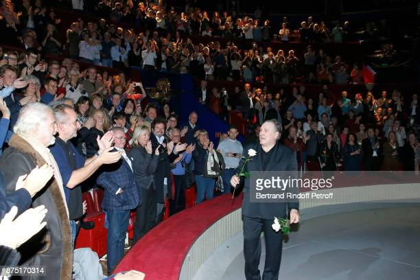 JeanPaul Belmondo and Antoine Dulery applausing Gerard Depardieu who acknowledges the applause of the audience and gives flowers to his fans at the...