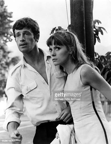 "Jean-Paul Belmondo and Frantoise DorlTac flee in a scene from the United Artist movie ""That Man from Rio"", circa 1964."