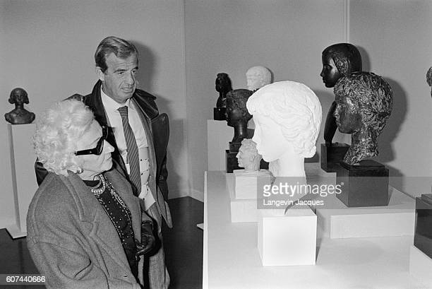 Jean-Paul Belmondo and his mother open open a sculpture exhibition for his father Paul Belmondo at Forum des Halles in Paris on November 7, 1985....
