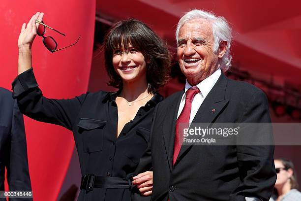 JeanPaul Belmondo and Sophie Marceau arrives at the Sala Grande for JeanPaul Belmondo Golden Lion for His Career 2016' during the 73rd Venice Film...