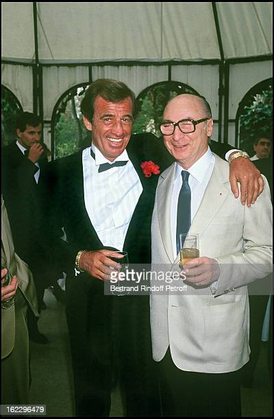 Jean-Paul Belmondo at his daughter Patricia's wedding in 1986, with Gerard Oury .