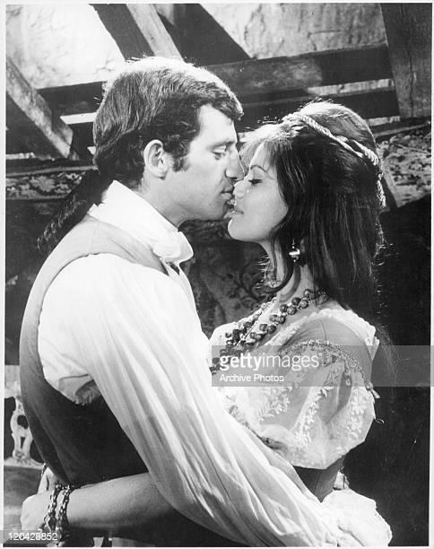 JeanPaul Belmondo embraces Claudia Cardinale in a scene from the film 'Cartouche' 1962
