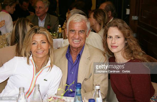 Jean-Paul Belmondo, his wife Natty and Florence Darel visit the Roland Garros village during the 2005 French Open Tennis.