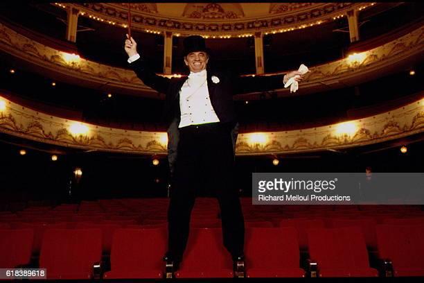 Jean-Paul Belmondo in the empty auditorium of the 'Theatre de Paris'.