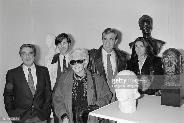 JeanPaul Belmondo opens an exhibition for his father Paul Belmondo's sculpture at Forum des Halles in Paris on November 7 1985 Left to right are...