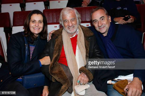 JeanPaul Belmondo sitting between Pascale Pouzadoux and her husband Antoine Dulery attend 'Depardieu Chante Barbara' at 'Le Cirque D'Hiver' on...