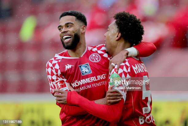 Jean-Paul Boetius of 1. FSV Mainz 05 celebrates with Jeremiah St. Juste after scoring their side's first goal during the Bundesliga match between 1....