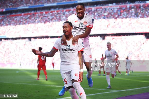 JeanPaul Boetius of 1 FSV Mainz celebrates after scoring his team's first goal during the Bundesliga match between FC Bayern Muenchen and 1 FSV Mainz...