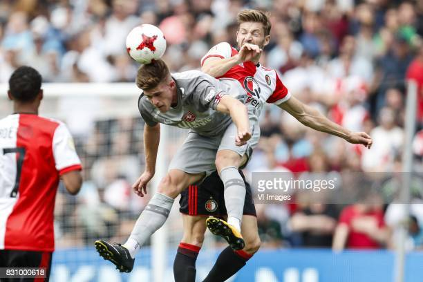 JeanPaul Boetius of Feyenoord Marko Kvasina of FC Twente JanArie van der Heijden of Feyenoord during the Dutch Eredivisie match between Feyenoord...