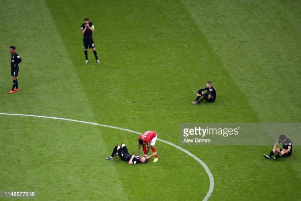 Jean-Paul Boetius of Mainz consoles players of Frankfurt after the Bundesliga match between Eintracht Frankfurt and 1. FSV Mainz 05 at...