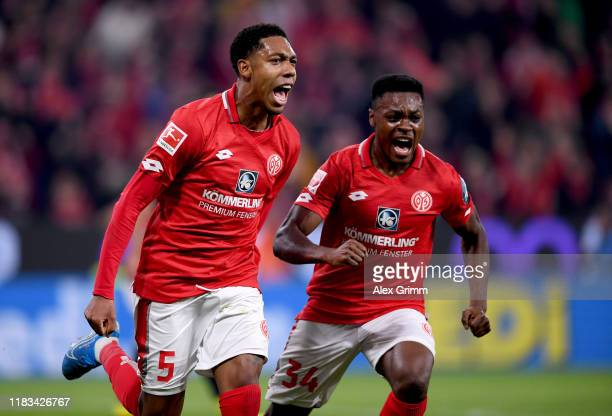 JeanPaul Boëtius of 1FSV Mainz 05 celebrates with Ridle Baku of 1FSV Mainz 05 after he scores their first goal the Bundesliga match between 1 FSV...