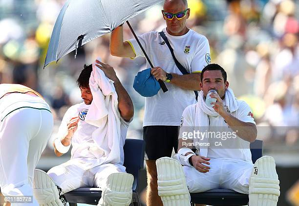 JeanPaul Duminy and Dean Elgar of South Africa cool off during a drinks break during day three of the First Test match between Australia and South...