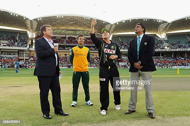 JeanPaul Duminy of South Africa and Aaron Finch of Australia toss the coin before the start of the match before game one of the International...