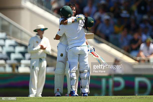 JeanPaul Duminy of South Africa celebrates his century with Dean Elgar during day three of the First Test match between Australia and South Africa at...