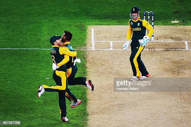 JeanPaul Duminy of South Africa celebrates the wicket of Ross Taylor of New Zealand with Francois du Plessis of South Africa during the 2015 Cricket...