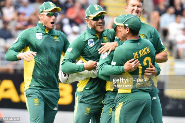 JeanPaul Duminy of South Africa celebrates with his team mate Quinton de Kock the run out of Mitchell Santner of New Zealand during the final match...