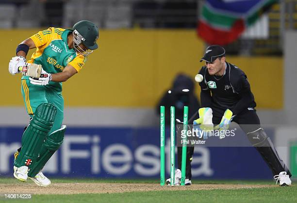 JeanPaul Duminy of South Africa is bowled by Rob Nicol of New Zealand during the One Day International match between New Zealand and South Africa at...