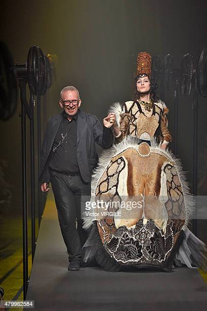 JeanPaul Gaultier and Anna Cleveland walk the runway during the JeanPaul Gaultier show as part of Paris Fashion Week Haute Couture Fall/Winter...
