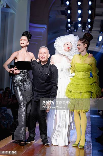 JeanPaul Gaultier arrives at the end of the show with models Ana Cleveland Soo Joo Park and Coco Rocha during the JeanPaul Gaultier Haute Couture...