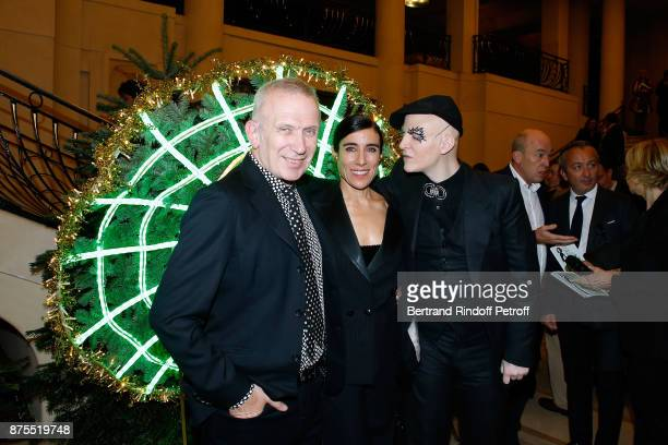 JeanPaul Gaultier Blanca Li and Ali Mahdavi pose in front of JeanPaul's Christmas Tree during the 22th Edition of ''Les Sapins de Noel des Createurs...