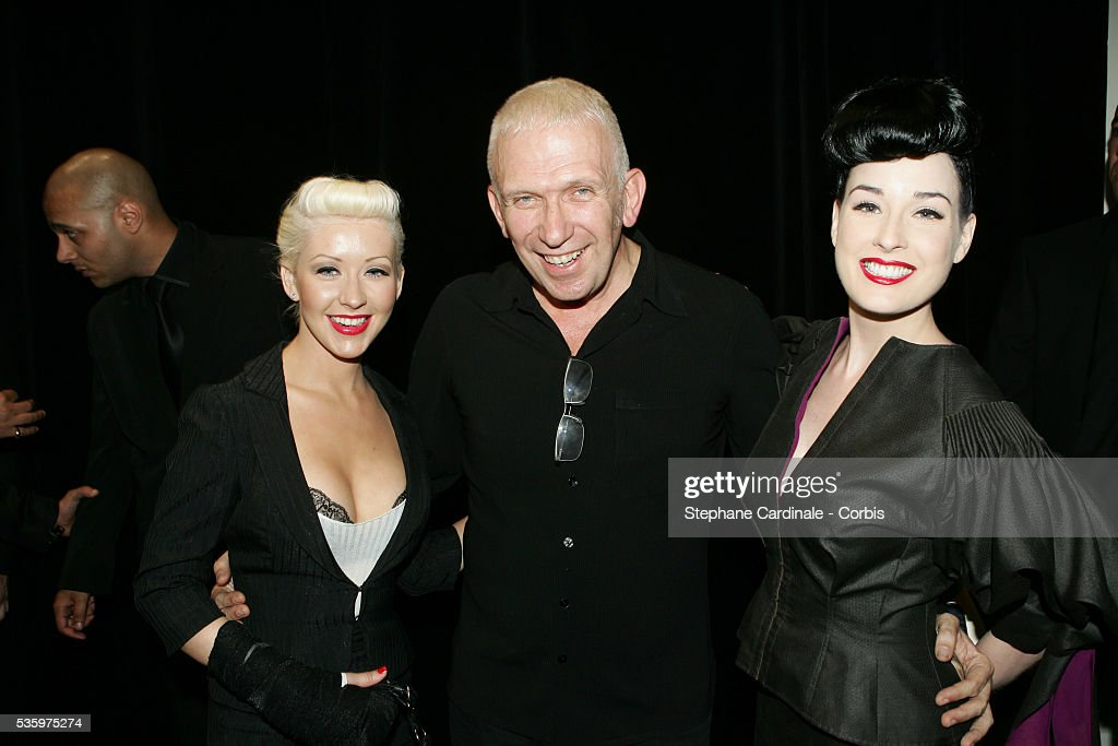 Jean-Paul Gaultier meets Dita Von Teese and Christina Aguilera backstage after the presentation of his 'Haute Couture' 2005-2006 Fall-Winter fashion collection.