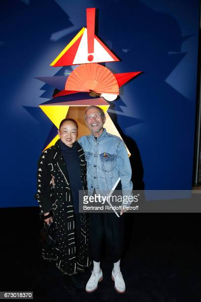 JeanPaul Goude and his wife Karen pose in front the works of JeanPaul Goude during the Societe des Amis du Musee d'Art Moderne du Centre Pompidou...