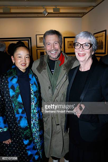 JeanPaul Goude standing between his wife Karen Park Goude and Sylvie Grumbach attend the Carla Sozzani Photo Exhibition at Azzedine Alaia Gallery on...