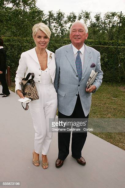"""Jean-Paul Guerlain and a friend attend the Christian Dior """"Haute Couture"""" Fall/Winter 2004-2005 fashion show collection in Paris."""