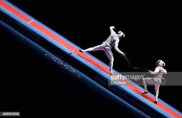 JeanPaul Tony Helisssey of France competes against Artur Akhmatkhuzin of Russia during the Men's Foil Team Gold Medal Match bout on Day 7 of the Rio...