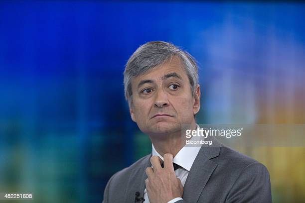 JeanPhilippe Courtois president of Microsoft International adjusts his tie during a Bloomberg Television interview in London UK on Wednesday July 29...