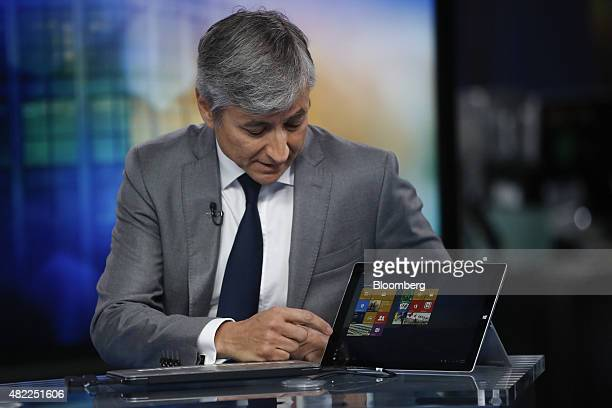 JeanPhilippe Courtois president of Microsoft International demonstrates features of Microsoft Corp's new Microsoft 10 operating system on a Surface...