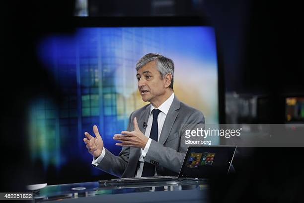 JeanPhilippe Courtois president of Microsoft International gestures as he sits beside a Microsoft Corp Surface tablet device during a Bloomberg...