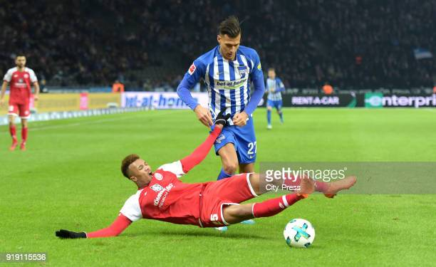 JeanPhilippe Gbamin of FSV Mainz 05 and Davie Selke of Hertha BSC during the first Bundesliga game between Hertha BSC and 1st FSV Mainz 05 at...