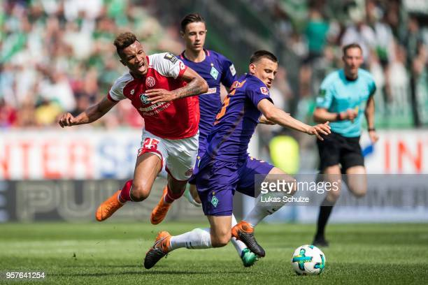 Jean-Philippe Gbamin of Mainz and Maximilian Eggestein of Bremen in action during the Bundesliga match between 1. FSV Mainz 05 and SV Werder Bremen...