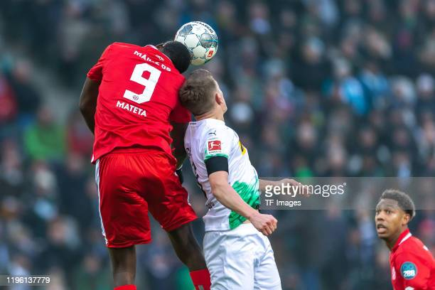 JeanPhilippe Mateta of 1 FSV Mainz 05 and Matthias Ginter of Borussia Moenchengladbach battle for the ball during the Bundesliga match between...