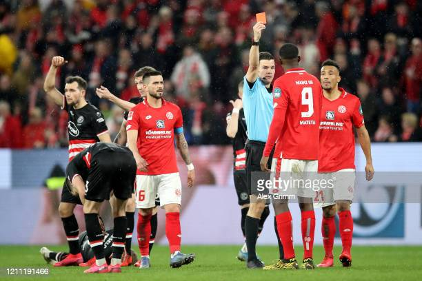Jean-Philippe Mateta of 1.FSV Mainz 05 gets a red card during the Bundesliga match between 1. FSV Mainz 05 and Fortuna Duesseldorf at Opel Arena on...