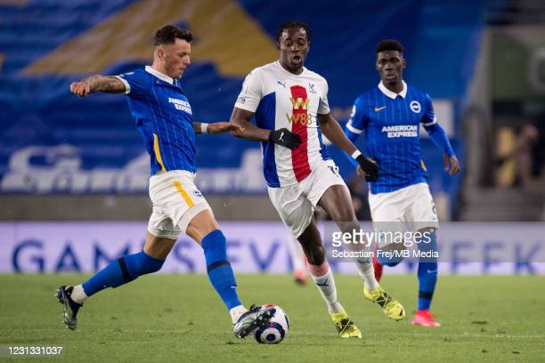 Jean-Philippe Mateta of Crystal Palace and Yves Bissouma, Joel Weltman of Brighton & Hove Albion in action during the Premier League match between...