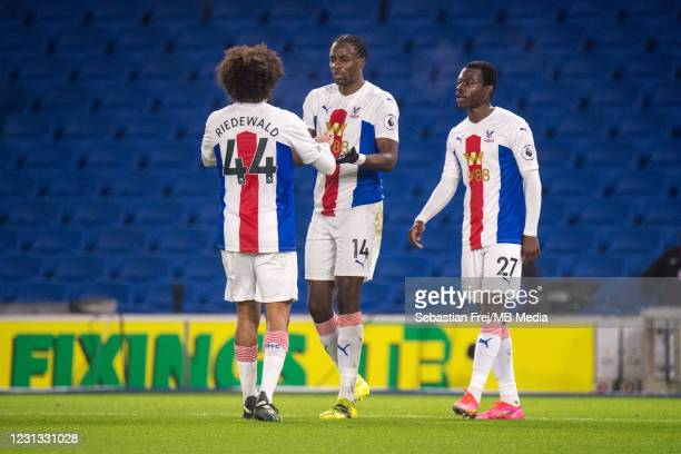 Jean-Philippe Mateta of Crystal Palace celebrate with his teammates Jaïro Riedewald and Tyrick Mitchell after scoring 1st goal during the Premier...