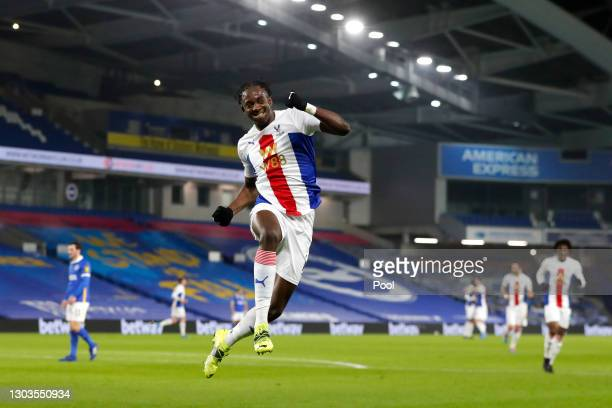 Jean-Philippe Mateta of Crystal Palace celebrates after he scores their team's first goal during the Premier League match between Brighton & Hove...